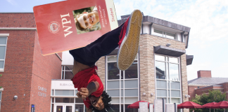 Giant student ID is spun in a sign-twirling fashion outside the CC